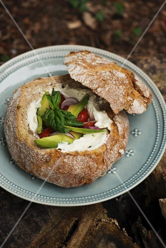Stuffed bread with sour cream, avocado and tomatoes