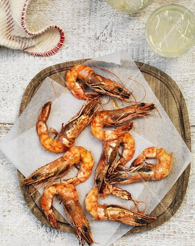 Grilled prawns on parchment paper