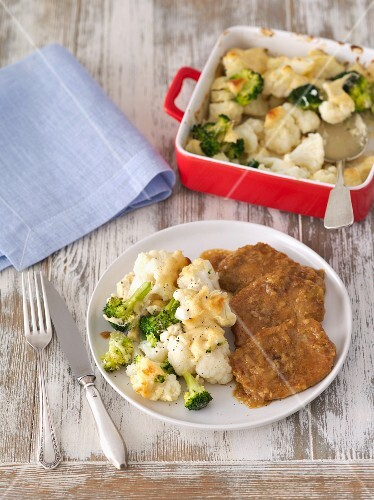 Cauliflower and broccoli bake with cream and mascarpone served with braised pork loin