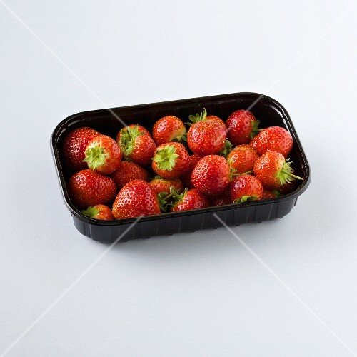 Strawberries in plastic punnet