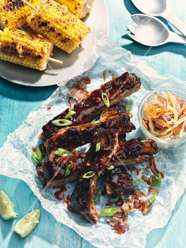 Smoked pork ribs with corn cobs and coleslaw