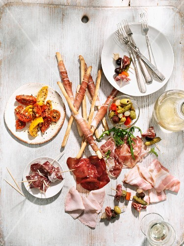 Antipasti with sausage, ham, pickles and grissini