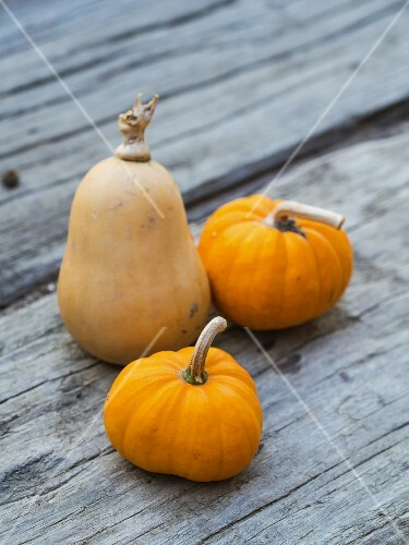 Fresh pumpkins on a wooden surface
