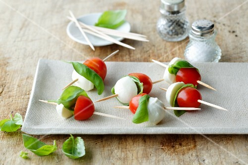 Mini tomato and mozzarella skewers with basil