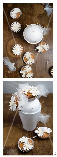 A bunch of cupcake flowers being made with sugar flowers and tulle