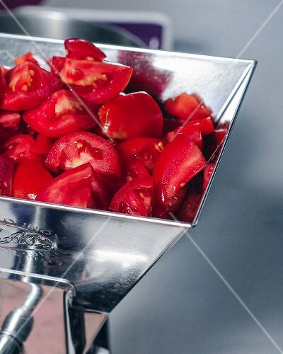 Chopped tomatoes in a mincer