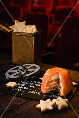 Smoked salmon terrine with star crackers and film decorations in a cinema