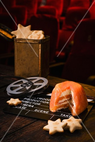 Smoked salmon terrine with star-shaped crackers and a film-themed decorations in a cinema