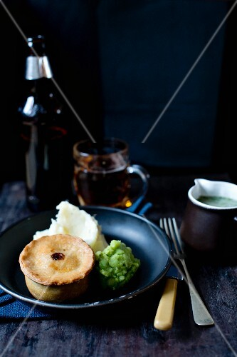A meat pie with mashed potatoes and mushy peas (Great Britain)