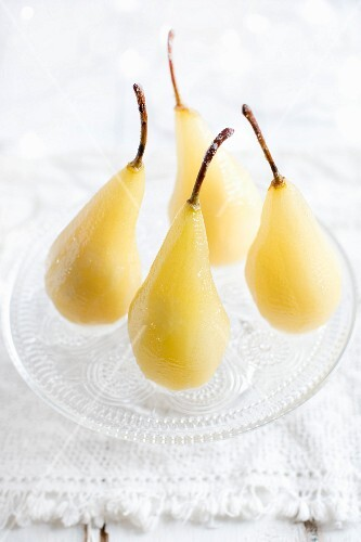 Poached pears on a glass plate