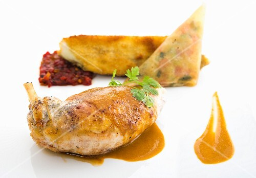Stuffed guinea fowl with chorizo served with pepper chutney and fried aubergine