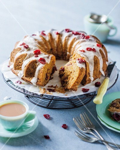 A carrot wreath cake with cranberries and cinnamon