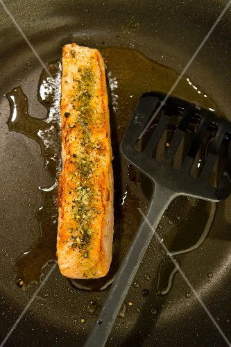 Fried salmon in a pan