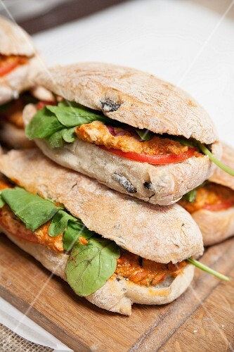 A tomatoes and basil sandwich on olive ciabatta
