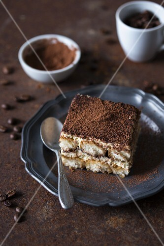 A piece of tiramisu on a plate