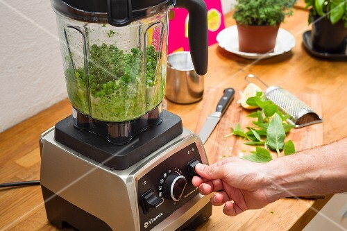 Peas being puréed in a blender