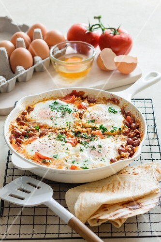 Tomato and bean stew with chorizo and fried eggs