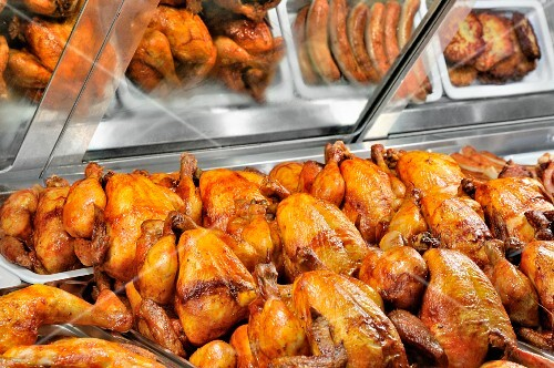 Grilled chicken and other grilled meats in a fast food display