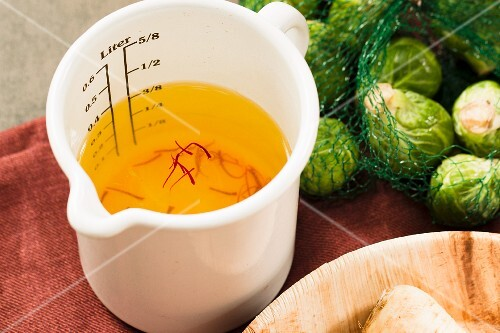 Vegetable broth coloured with saffron threads