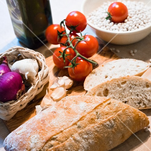 An arrangement of ciabatta, garlic, lentils, tomatoes and onions