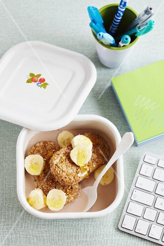 Weetabix, banana, honey and flavoured milk in a Tupperware box