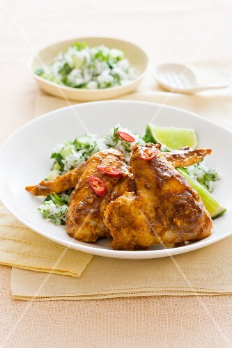 Chicken wings with curry, chillis and herb rice