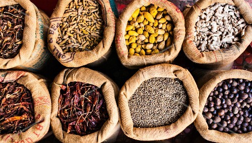 Dried spices and nuts at a street market in India