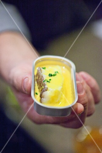 Cod in saffron sauce in an opened tin