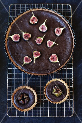 A large chocolate cake with figs and two fig tartlets