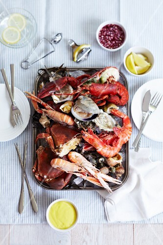 A mixed seafood platter including prawns, crab, mussels, oysters and scallops with a lemon mayonnaise