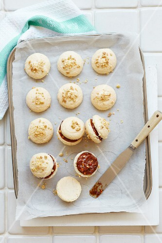 Macaroons with a peanut and chocolate filling and chopped peanuts