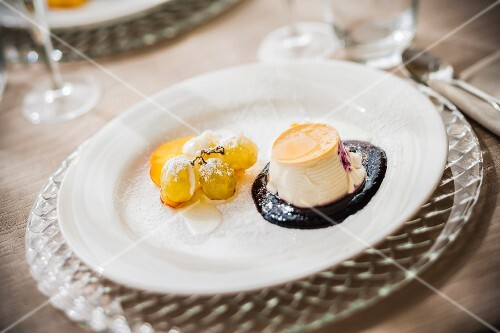 Festive panna cotta in a berry sauce