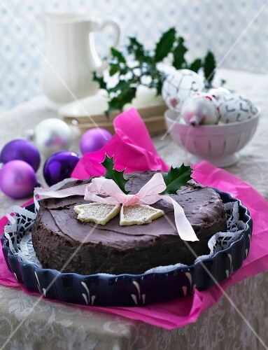 A festive Christmas chocolate cake decorated with a ribbon