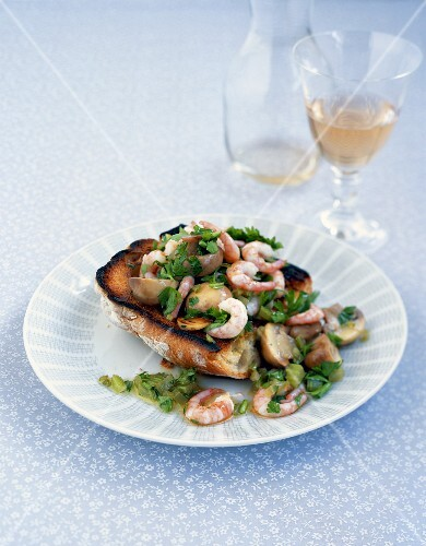 Warm bruschetta topped with mushrooms and prawns