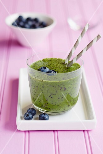 Kiwi smoothie garnished with blueberries