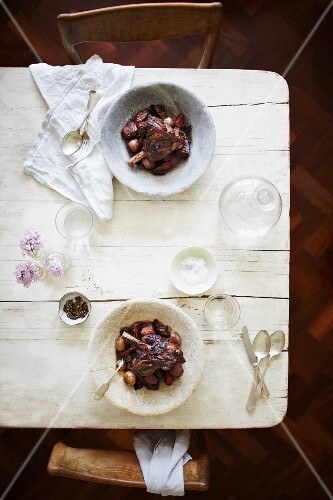 Leg of lamb with red onions, shallots, rosemary and potatoes in a red wine sauce