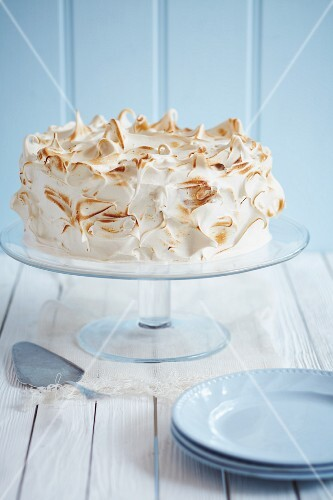 A celebration cake topped with meringue