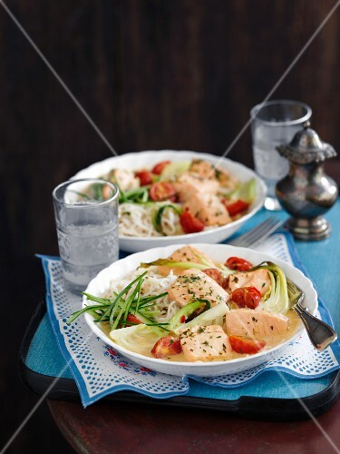 Salmon laksa with cherry tomatoes, bok choy and rice noodles