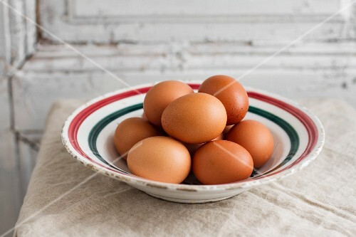 Brown eggs on a vintage plate