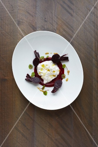 Burrata on a bed of beetroot