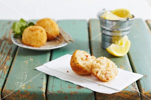 Breaded crab dumplings served with lemon wedges