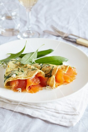 Spinach pancakes filled with smoked salmon and wild garlic