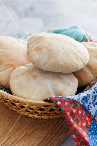 Freshly baked pita bread in a bread basket
