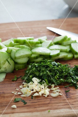 Sliced cucumber, fresh parsley and garlic for a salad