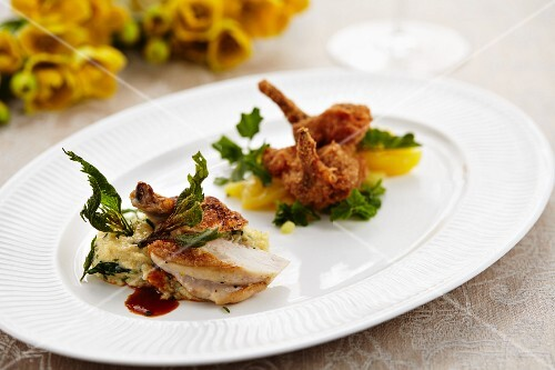 A duo of spring chickens on a bed of stinging nettle polenta and a potato and watercress salad