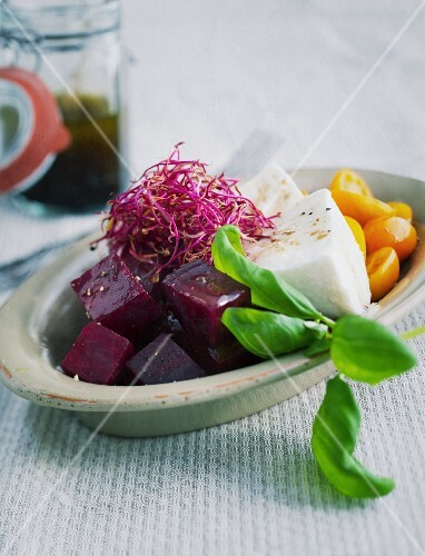 Beetroot with buffalo mozzarella, yellow tomatoes and beetroot shoots