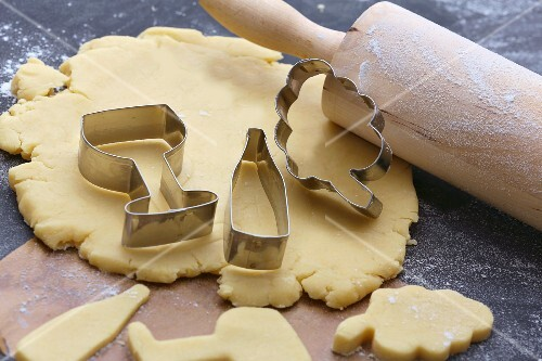 Biscuit pastry, a rolling pin and cutters