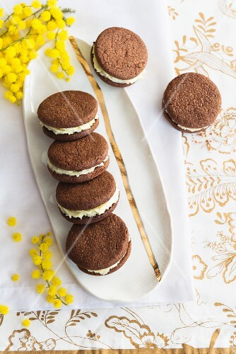 Chocolate biscuits filled with cream