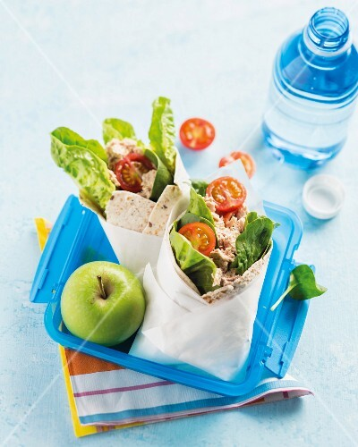 Spinach and tuna wraps in a lunch box