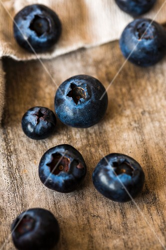 Blueberries on a wooden surface (close-up)